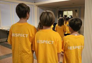 Franklin School kicks of the Week of Respect with an assembly focusing on the Six Pillars of Characters.  In this picture, a 5th grader wears a green teeshirt with