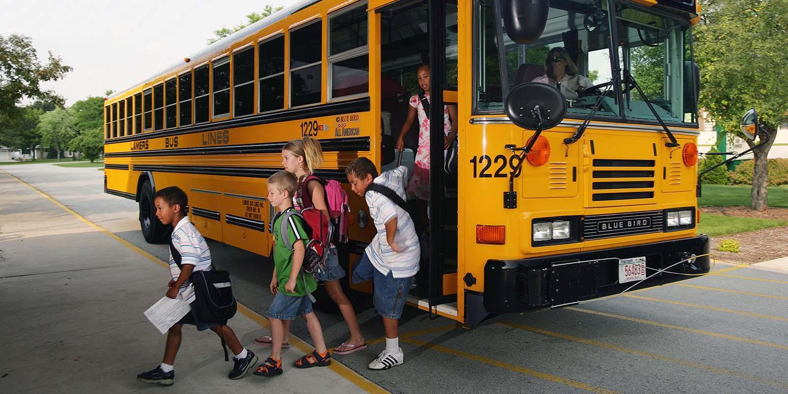 Children Exiting School Bus