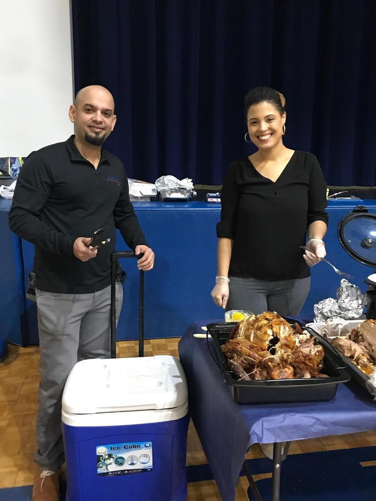 two teachers happily serving turkey