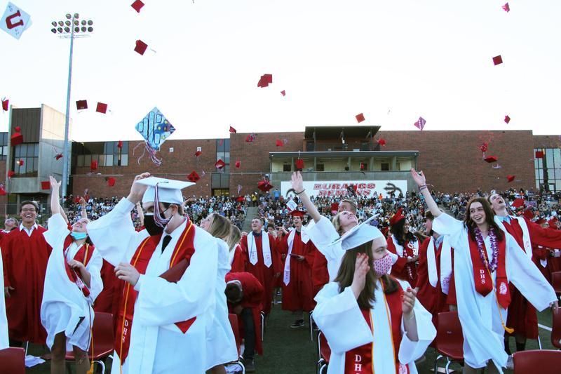graduates throw caps