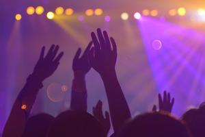 hands in air as people dance