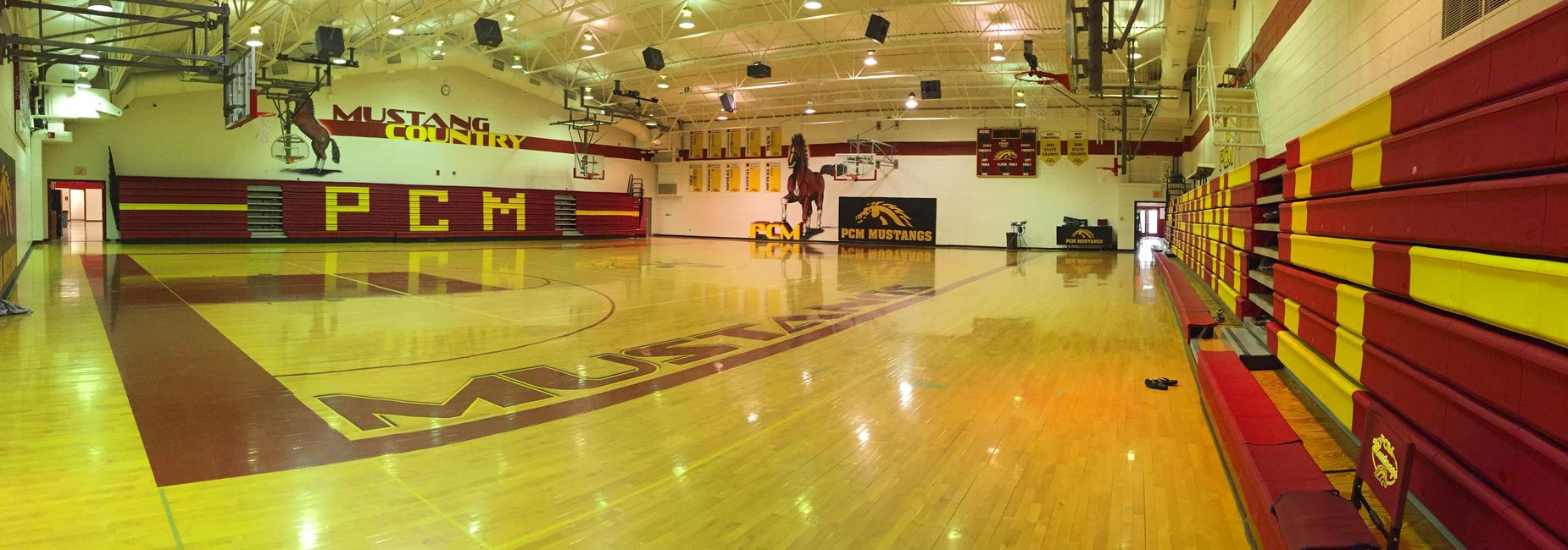 Wide shot of high school basketball gym