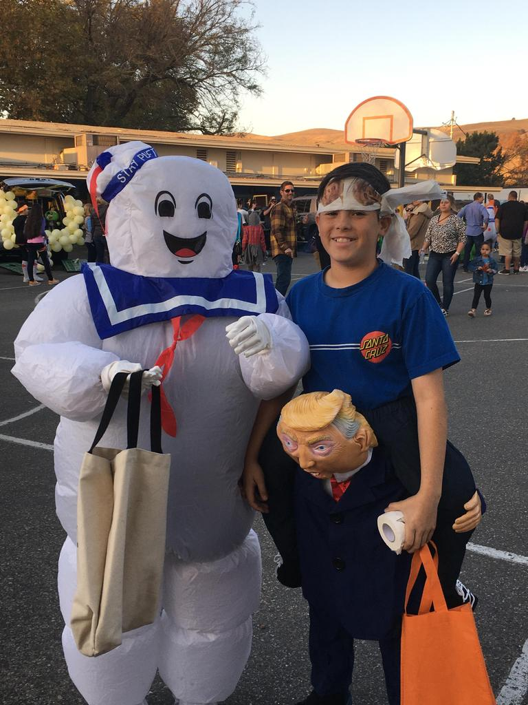 kids dressed as stay puff man and karate person