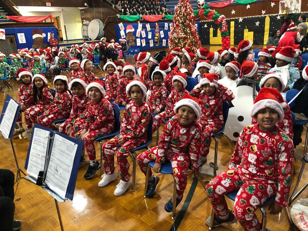 kindergarten class dressed in red matching christmas pj with santa hats