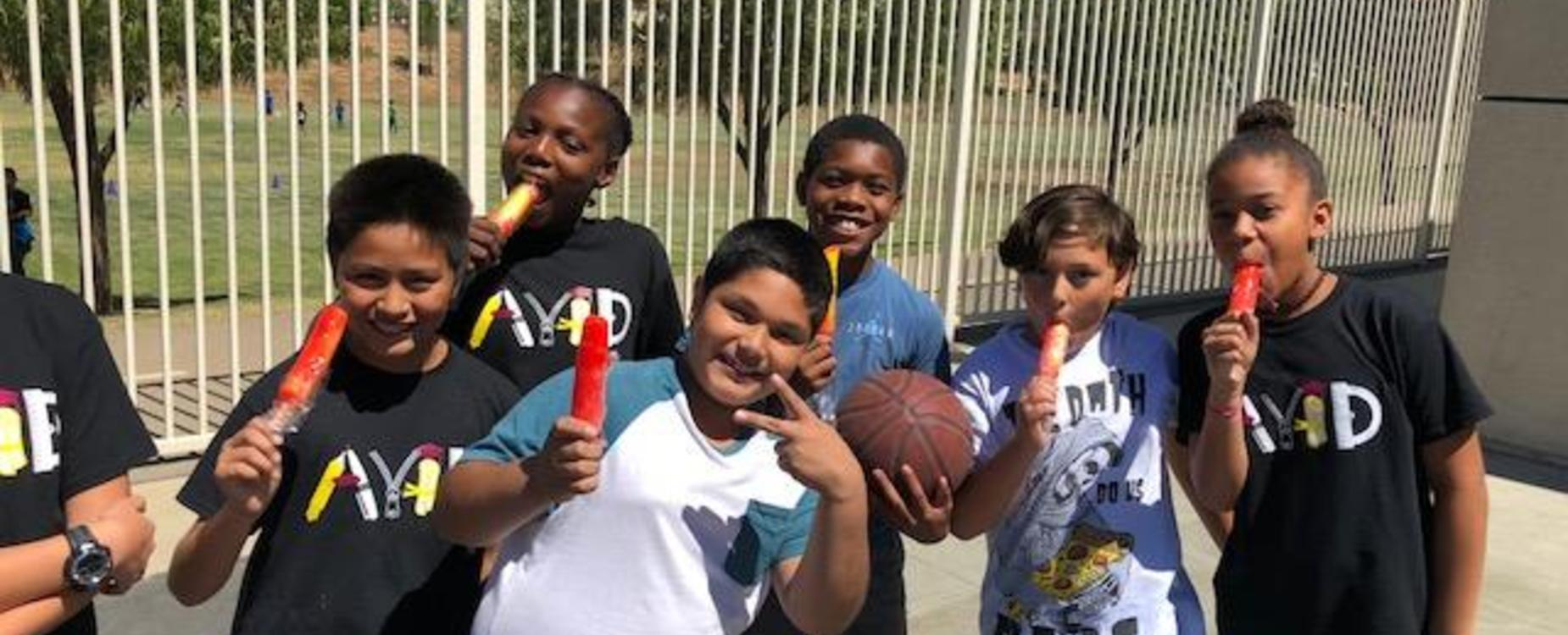 students having popsicles