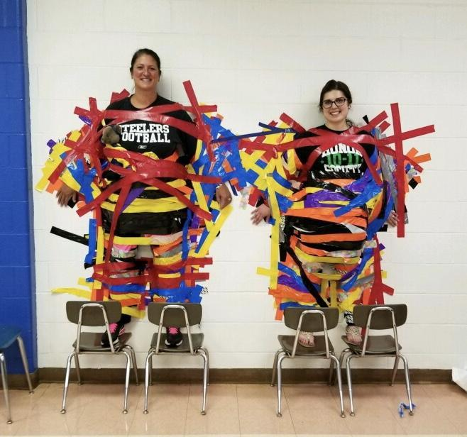 Dr. Shulsky & Ms. Westermayer taped to wall.