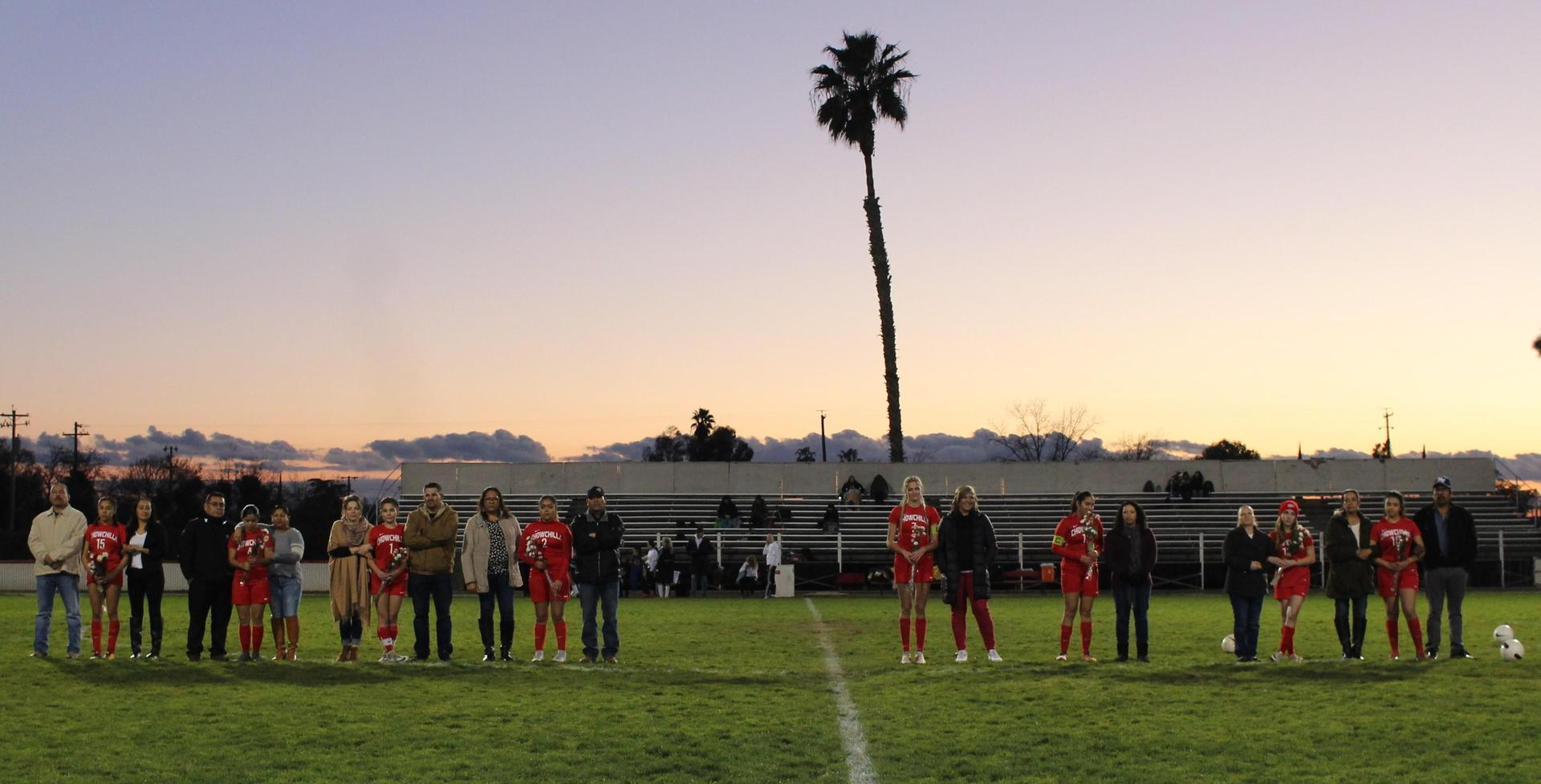 All the girls and their parents at soccer senior night
