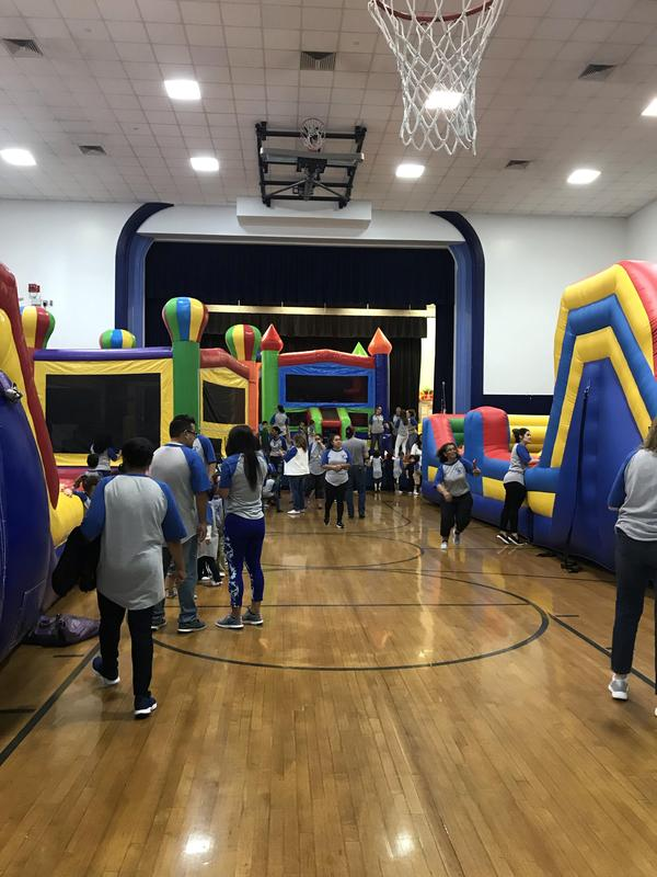 several bouncy house in the Veteran's School Gym