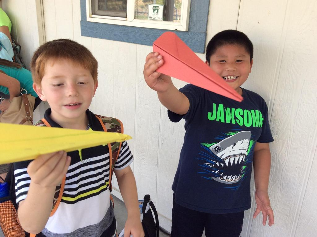 boys and paper airplanes