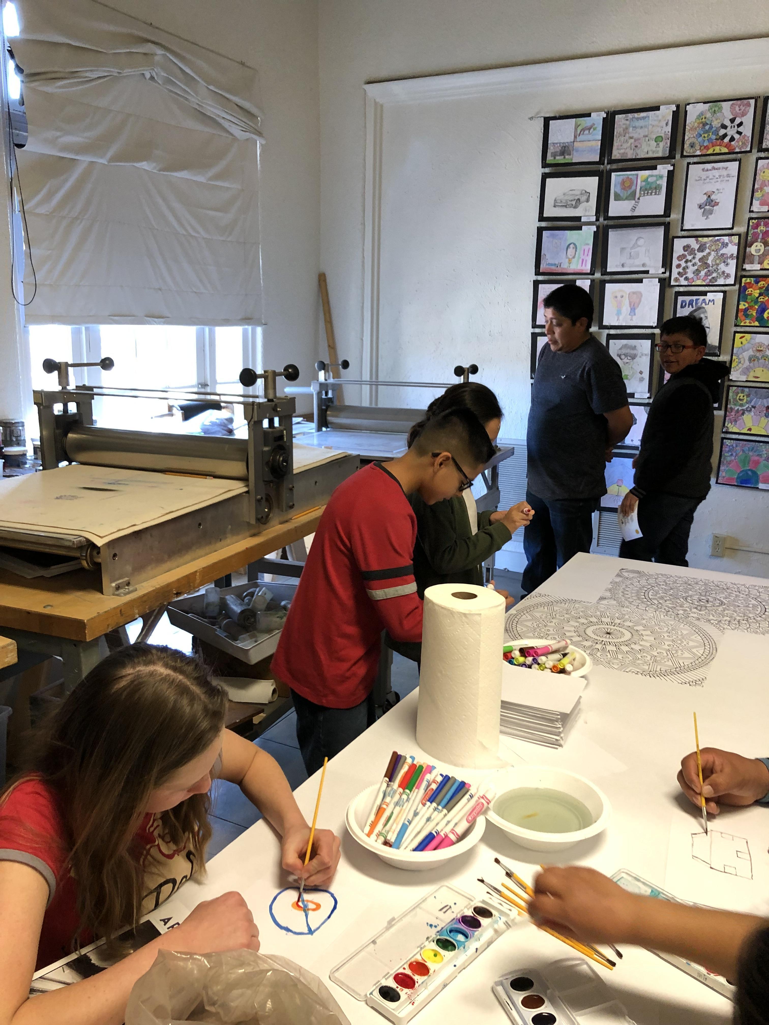 Students coloring mandala