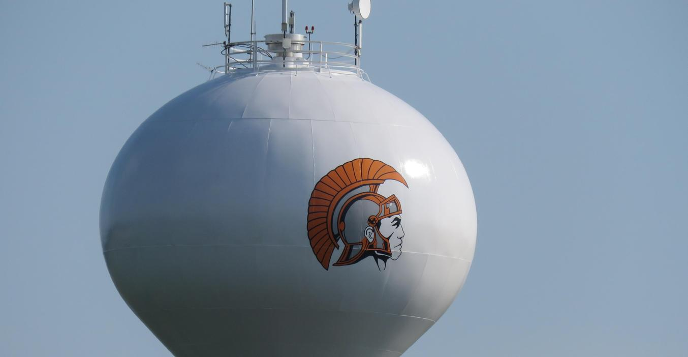 The TK Trojan logo is painted on the side of the water tower near the high school.