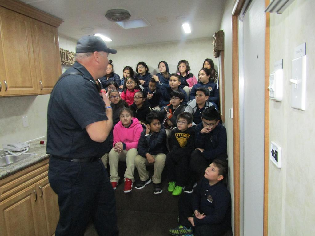 fireman talking to a class of students about fire safety