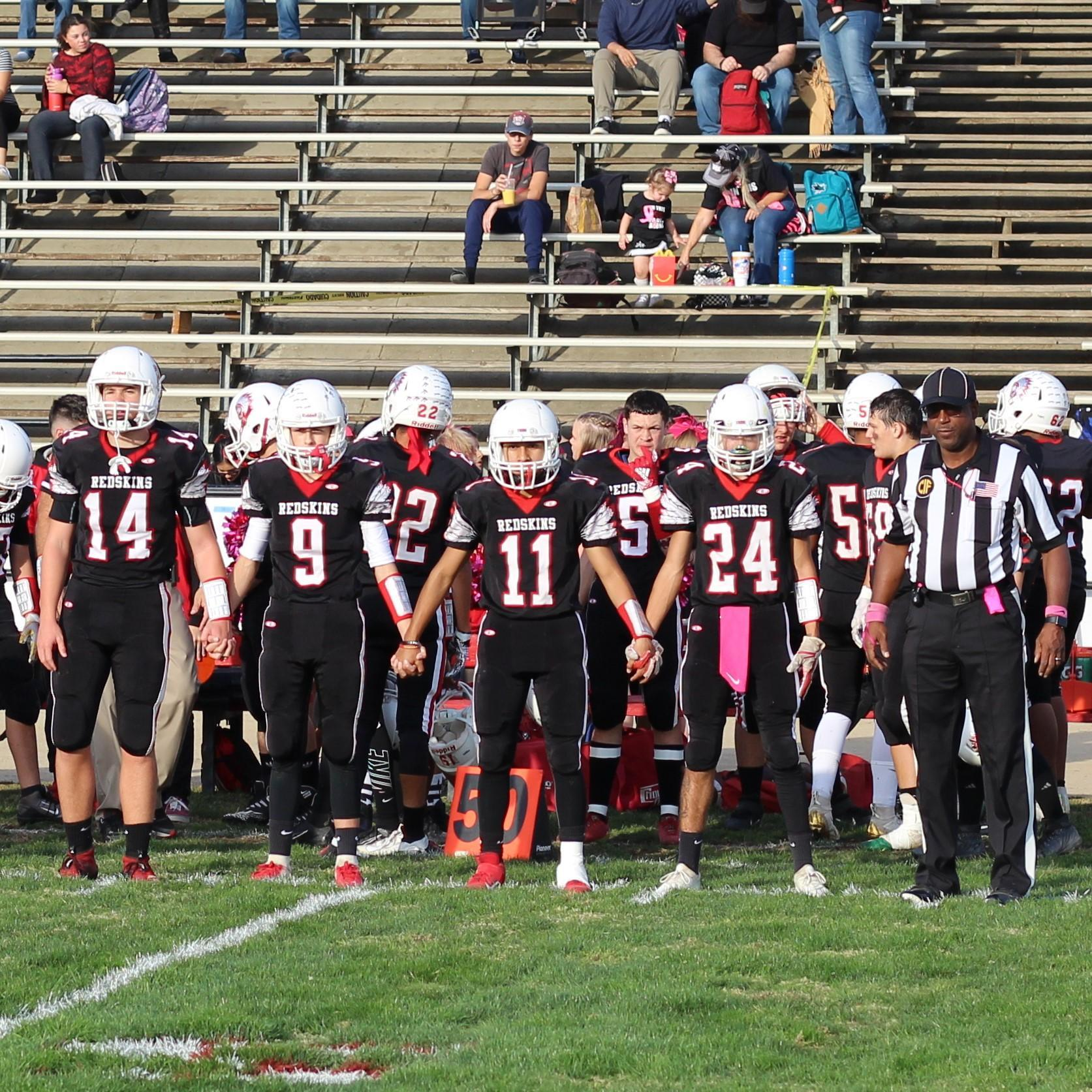Tribe Football Players Walking to Coin Toss