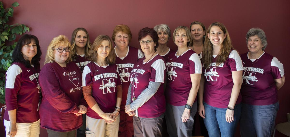 NPS nurses standing with matching nurse t-shirts