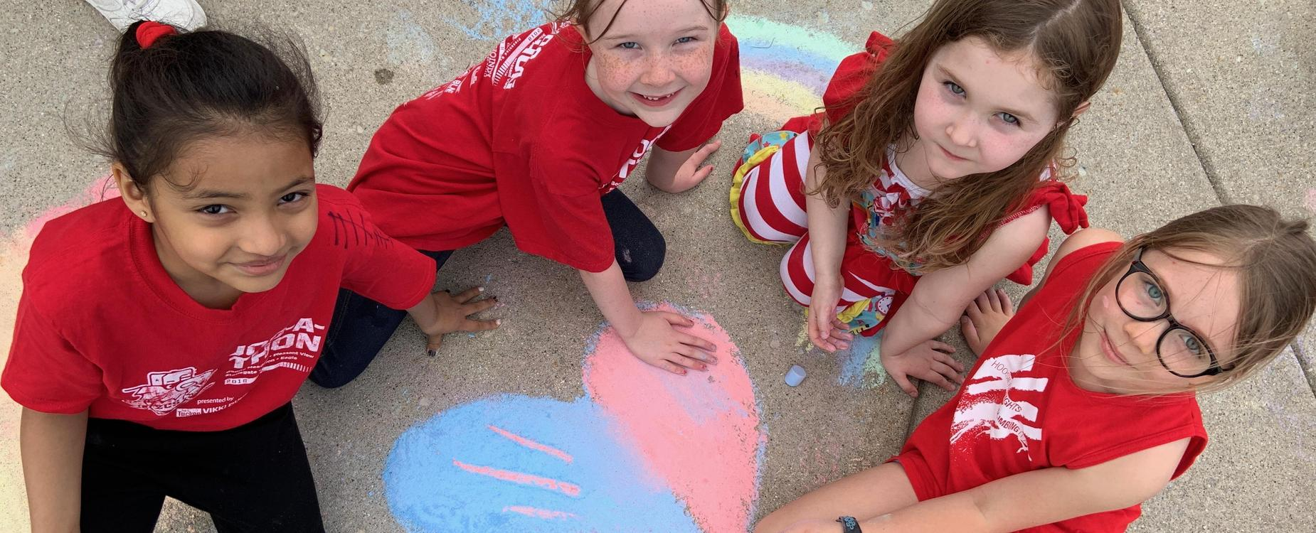 Stonegate students working with chalk on Field Day.