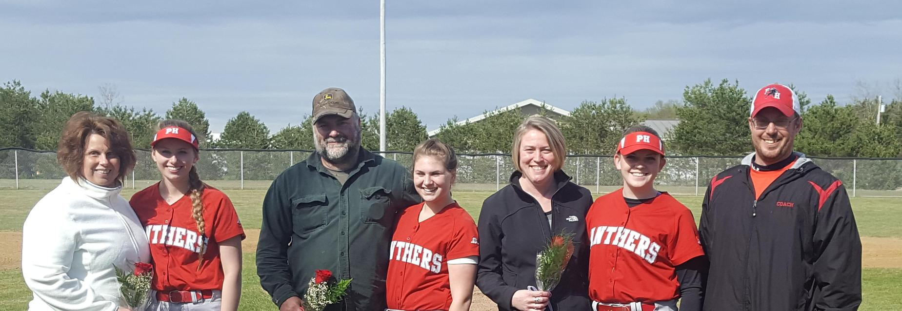 Softball players with their parents & coach