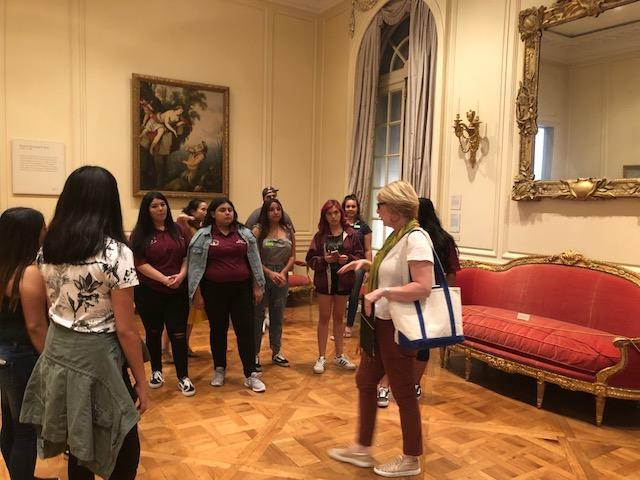 Students listening to docent