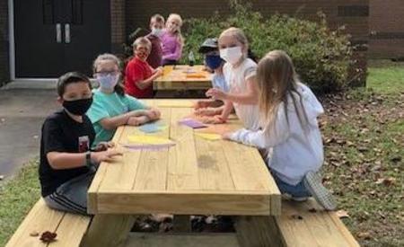 Students at a picnic table