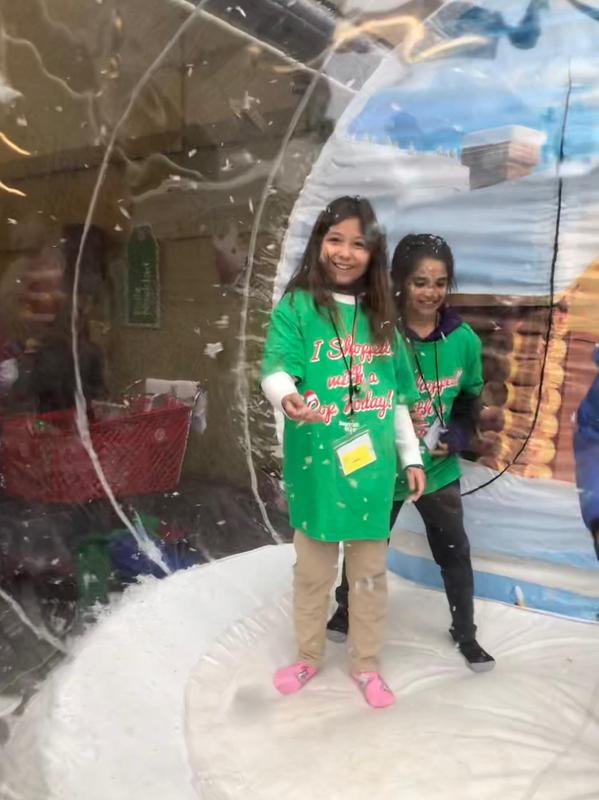 Students playing in giant snow globe, image 2
