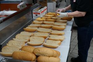 Child Nutrition worker preparing sandwiches in kitchen