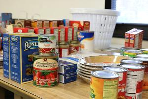 Photo of non-perishable food items being collected by WHS students during the holidays to donate to families in need.