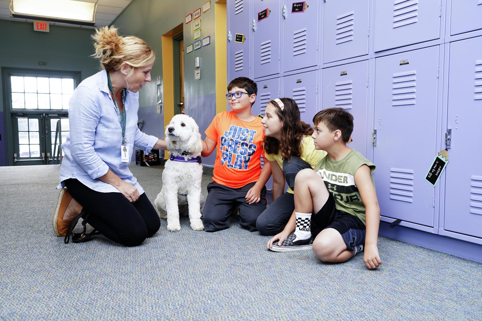 Lucy with Lower and Middle School Counselor Christy Zawadzkas and lower school students