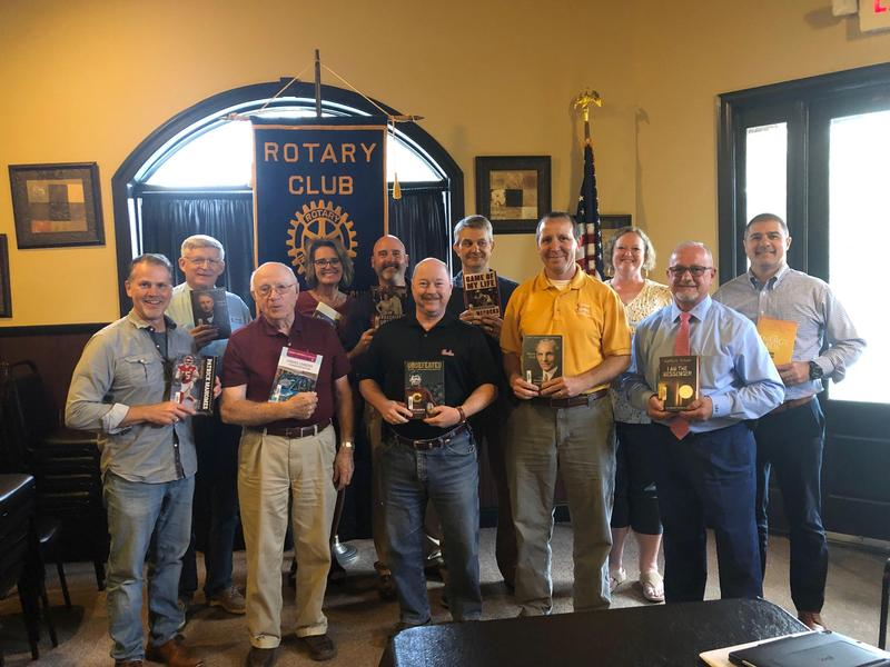Pictured are members of the Batesburg-Leesville Rotary Club showing off books that will compose the Centennial Collection at B-L High School.  Front row, left to right:  Mayor Lancer Shull, Otho Shealy, Eddie Cogdill, Darron Long, Landis Price.  Back row, left to right: Sam Coker, Angie Rye, Ted Luckadoo, Chris Spradley, Kelly Price (Media Specialist at BLHS), and Andy Bedenbaugh.