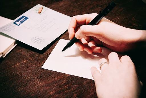 hand writing at a desk