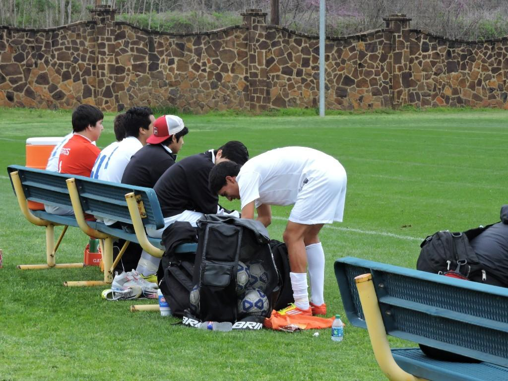 soccer players on the bench