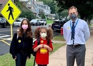 Photo of Franklin principal posing with students on Walk to School Day