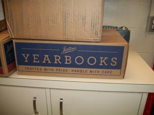 Box of yearbooks.