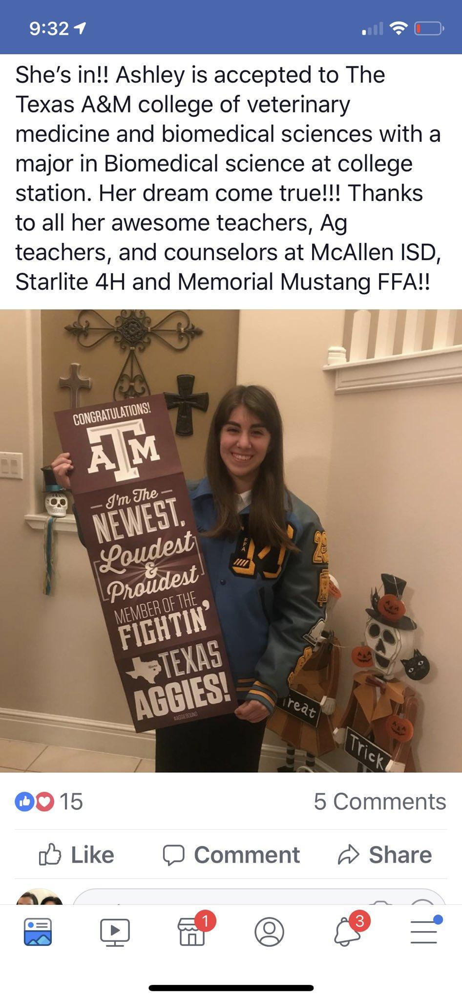 student holding banner showing acceptance to college