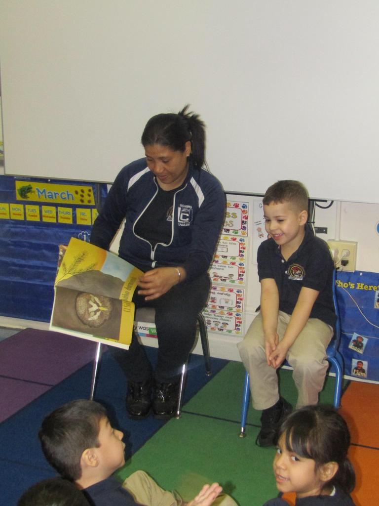 mother and son reading to class