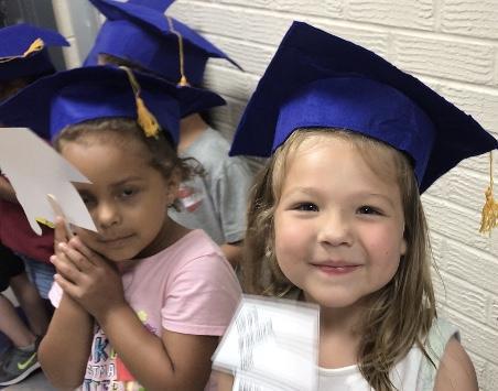 Springdale Elementary student saluting grads