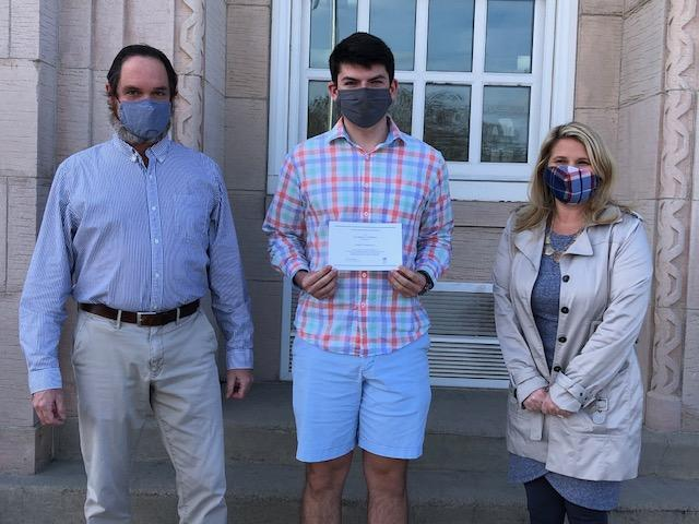 Brookland-Cayce High School senior Joseph Buchmaier, center, receives a Certificate of Merit for his selection as a finalist from Principal Gregg Morton and Assistant Principal Alicia Dickerson Helms.