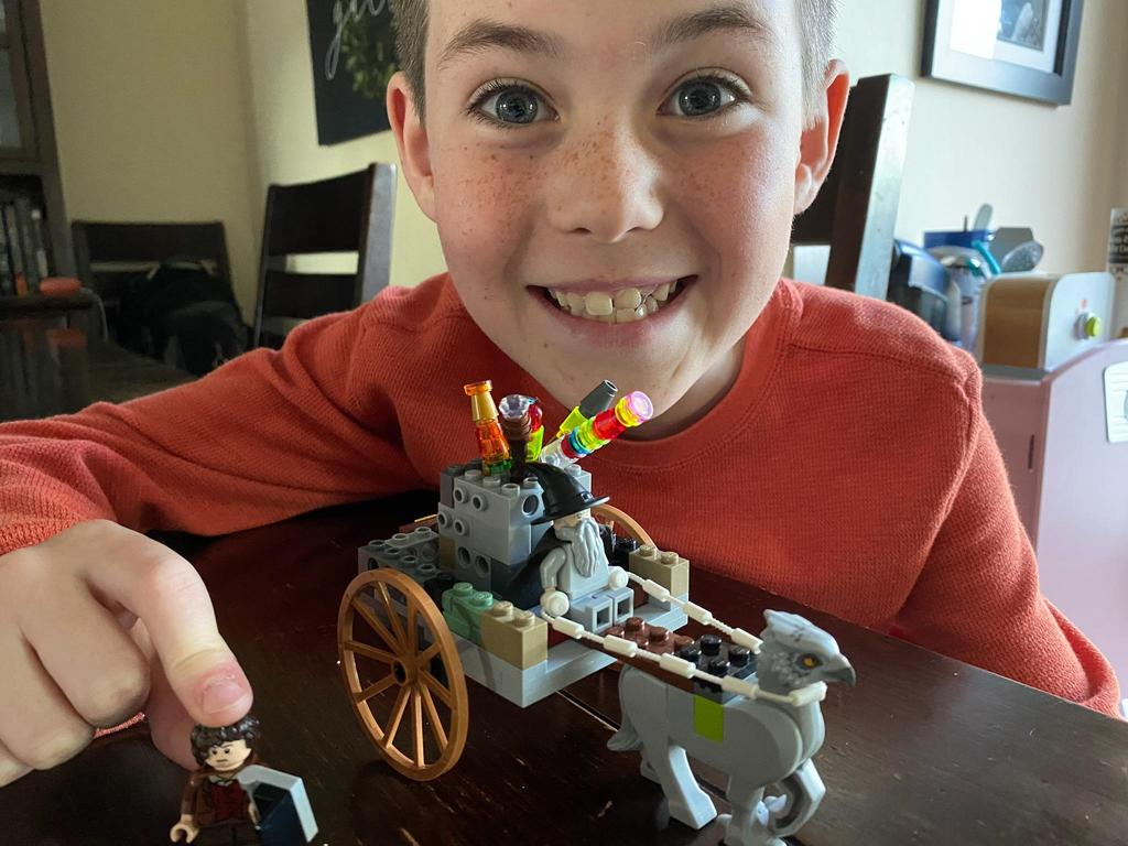 boy with harry potter lego creation