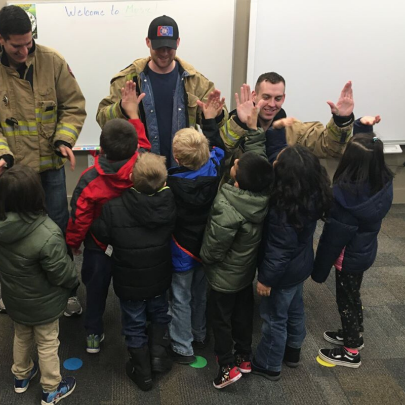students high five firefighters