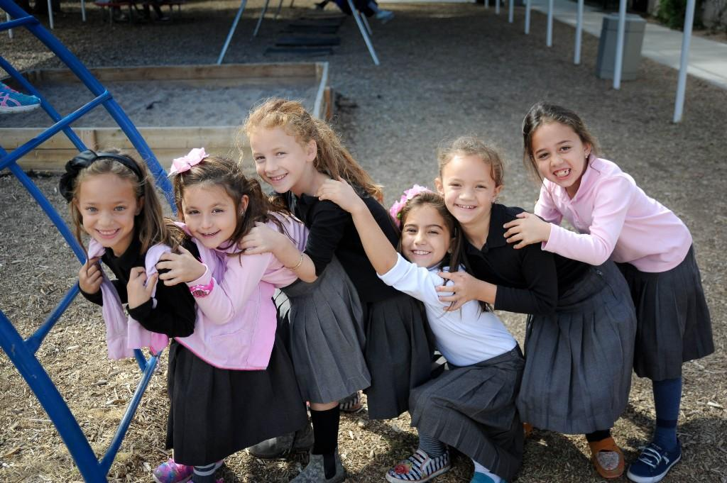 Girls playing outside on the playground