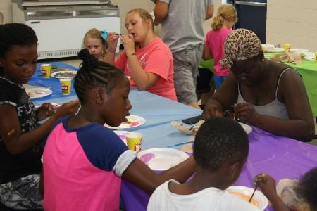 Parents and students painting rocks for Tifton Rocks.