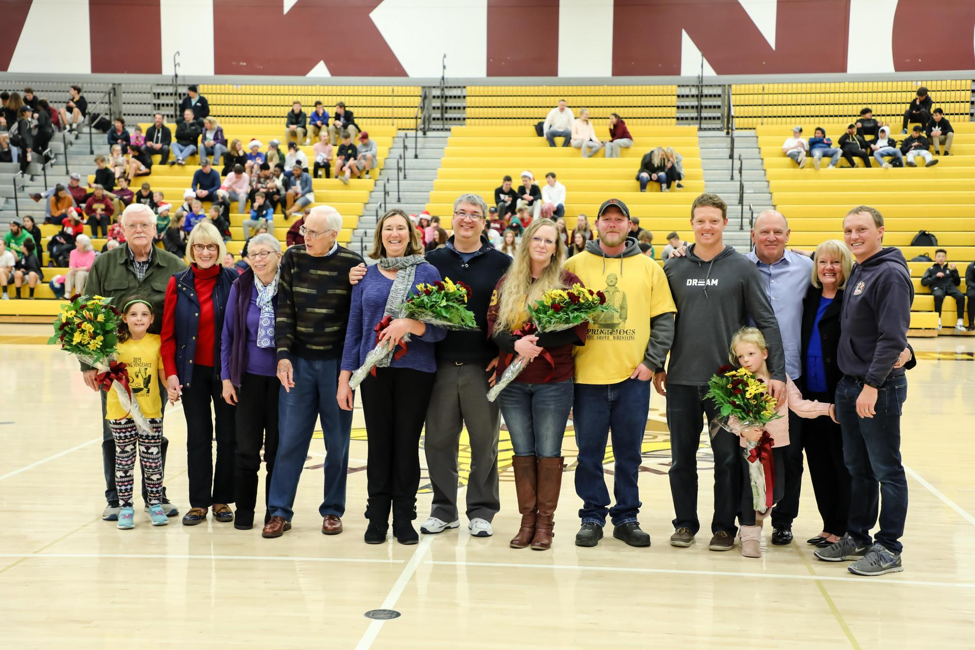 Hall of Fame Inductees standing in gym