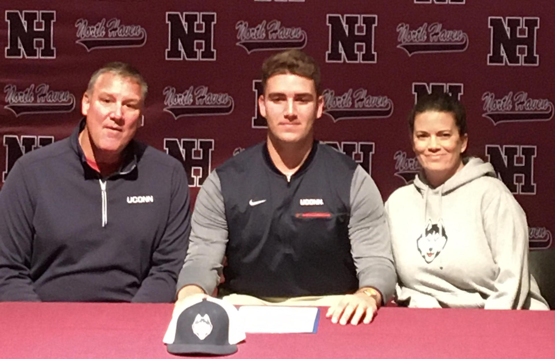 David Christoforo with his parents after signing his NLI.