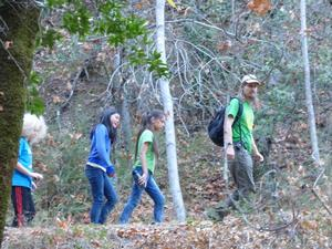 students being led on a hiking trail