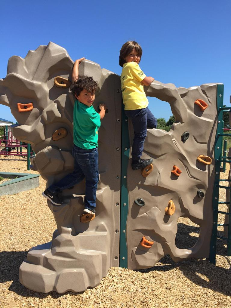 Two boys on the climbing wall