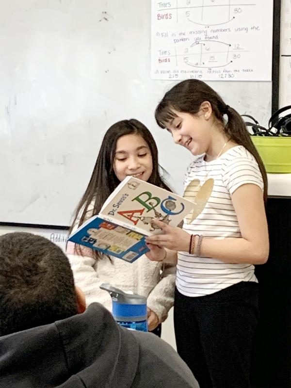 Two students read to their classmates