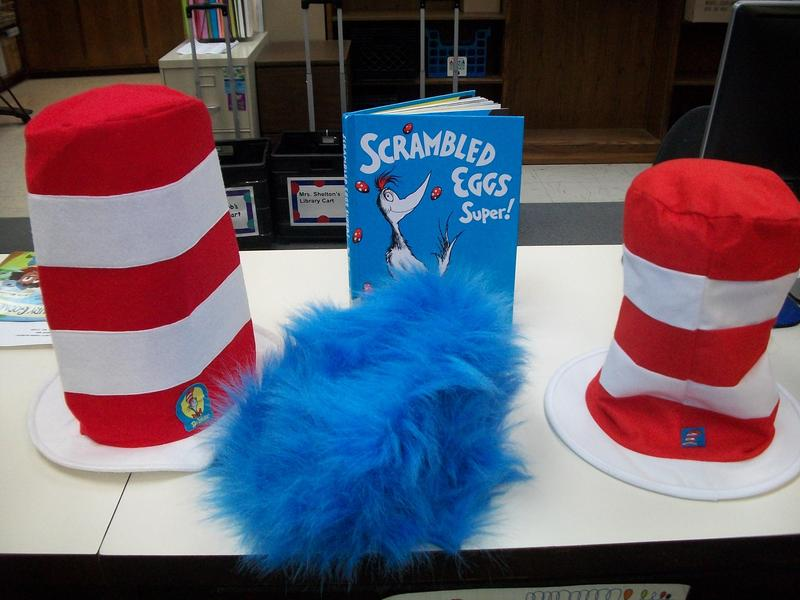 Picture of Dr. Seuss hats and a book.