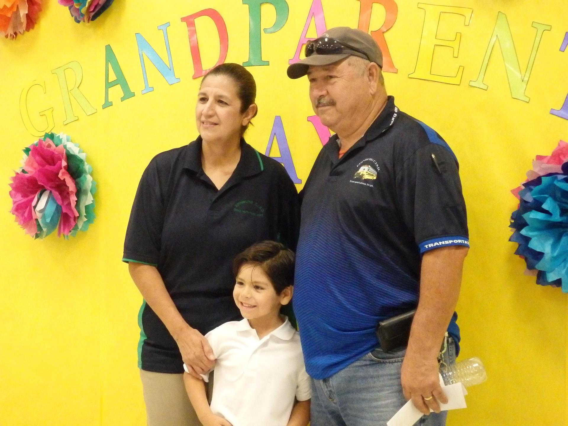 Parents and kinder student pose for picture after program