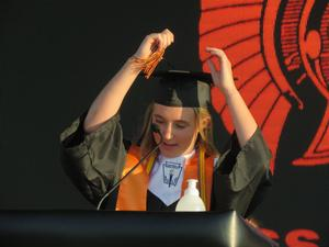 Ashley Snyder leads the class in the tassel ceremony.