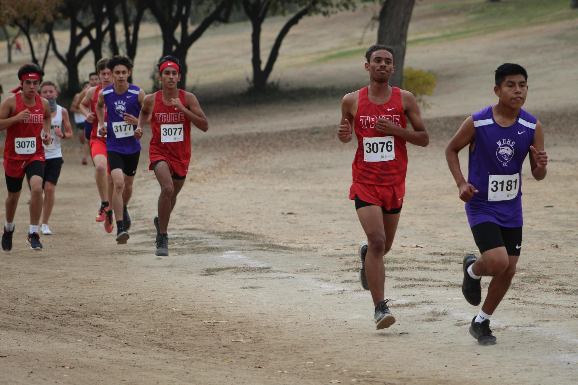 Lawerence Luna, Nicholas Martinez, and Raymond Mendoza racing at woodward park
