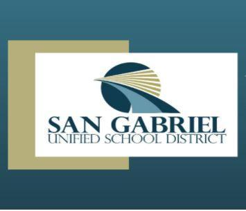 district logo with gold, blue, and white boxes