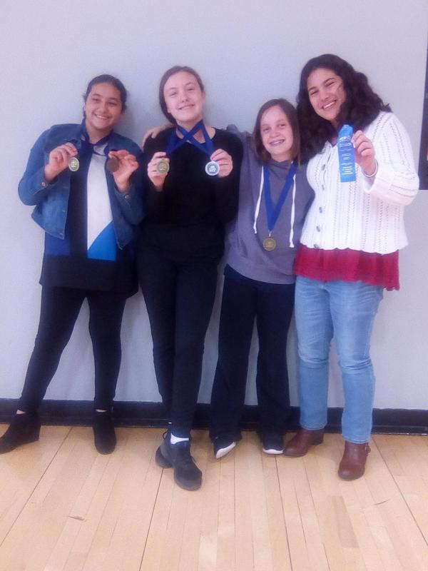 Students displaying their medals from junior high speech meet